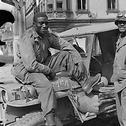Soldiers from a negro tank battalion 761 sitting on the hood of a Jeep. April 1945