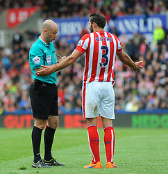 Referee Anthony Taylor gives a yellow card to Stoke City's Erik Pieters- Photo mandatory by-line: Nizaam Jones/JMP - Mobile: 07966 386802 - 24/05/2015 - SPORT - Football - Stoke - Britannia Stadium - Stoke City v Liverpool - Barclays Premier League