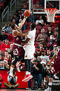 Louisville forward Mangok Mathiang, right, contests a shot by in the second half. The University of Louisville hosted Eastern Kentucky University, Saturday, Dec. 17, 2016 at The KFC Yum Center in Louisville. Louisville won 87-56.