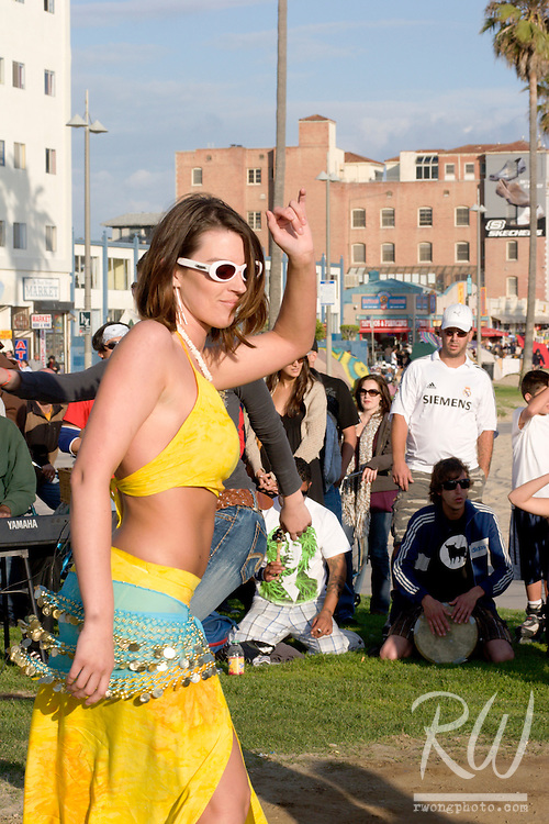 Young Woman in Bikini Dancing in Drum Circle, Venice Beach, California