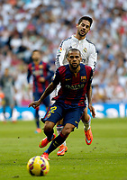 """Spanish  League""- match Real Madrid Vs FC Barcelona- season 2014-15 - Santiago Bernabeu Stadium - Isco (Real Madrid) and Dani Alves (FC Barcelona) in action during the Spanish League match(Photo: Guillermo Martinez / Bohza Press / Alter Photos)"