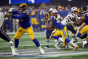 Los Angeles Rams running back Todd Gurley II (30) runs for a third quarter gain of 16 yards and a first down at the Rams 41 yard line during the NFL Super Bowl 53 football game against the New England Patriots on Sunday, Feb. 3, 2019, in Atlanta. The Patriots defeated the Rams 13-3. (©Paul Anthony Spinelli)