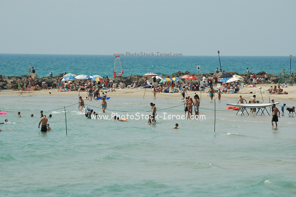 Israel, Haifa, People enjoying themselves at the beach. Spring May 2005