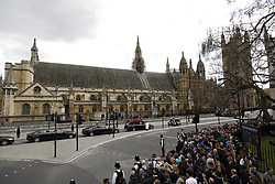 © Licensed to London News Pictures. 10/04/2017. London, UK. The funeral cortege carrying the coffin of policeman Keith Palmer leaves the Palace of Westminster through Carriage Gates. PC Palmer was murdered just inside the gate by Westminster attacker Khalid Masood - an attack in which he also killed four people on Westminster Bridge. PC Palmer's funeral will take place at Southwark Cathedral today. Photo credit: Peter Macdiarmid/LNP