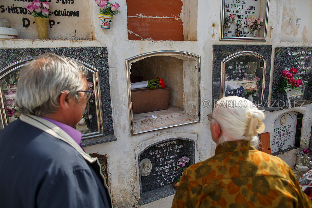 19/05/2018. Relatives stand in front of the remains of Eugenio Molina Morato who was assassinated by dictator Francisco Franco's forces during his inhumation at the cemetery on May 19, 2018 in Sacedon, Guadalajara province, Spain. General Franco's forces killed Timoteo Mendieta and other people between 1939 and 1940 after Spain's Civil War and buried them in mass graves in Guadalajara's cemetery. Argentinian judge Maria Servini used the international human rights law and ordered the exhumation and investigation of Mendieta's mass grave. The exhumation was carried out by Association for the Recovery of Historical Memory (ARMH) recovering 50 bodies from 2 mass graves and identified 24 of them. Spain's Civil War took the lives of thousands of people on both sides, but Franco continued his executions after the war has finished. Spanish governments has never done anything to help the victims of the Civil War and Franco's dictatorship while there are still thousands of people missing in mass graves around the country. (© Pablo Blazquez)