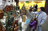 (counter-clockwise from bottom) Mela Stangle, 3; Grace Doyle, 9; Noah Hostutler, 1 and Terry Hostutler of New Albany watch the Huntington Holiday Train display setup at the main branch of the Columbus Metropolitan Library in downtown Columbus., Sunday, November 25, 2012..The trains are setup on Saturday and Sunday and will run through mid-January.