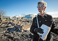 November 6th, NY, New York, Dorothy Raffo stands in front of  the ruins of her former home in Breezy Point , Queens that burnt to the ground when superstorm Sandy hit, holding a first edition of Hiroshima Diary, charred at the edges but still intact with her maiden name inscribed on it. Hurricane Sandy hit the try-state area as a tropical storm causing billions of dollars of damage and cutting electricity to hundreds of thousands. Extreme weather is being blamed on climate change by many scientist.