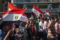 Protestors march near the presidential palace in Cairo.