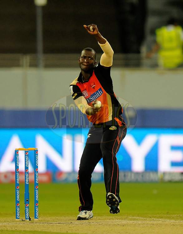 Darren Sammy of the Sunrisers Hyderabad bowls during match 20 of the Pepsi Indian Premier League Season 2014 between the Mumbai Indians and the Sunrisers Hyderabad held at the Dubai International Stadium, Dubai, United Arab Emirates on the 30th April 2014<br /> <br /> Photo by Pal Pillia / IPL / SPORTZPICS