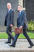 © Licensed to London News Pictures. 08/07/2014. Westminster, UK David Willetts, Conservative MP, Minister of State (Universities and Science) and Dominic Grieve QC, Conservative MP, Attorney General ,  arriving on Downing Street today 8th July 2014 for the weekly cabinet meeting. Photo credit : Stephen Simpson/LNP