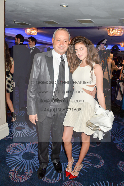 Naguib Sawiris and ? at the Chain of Hope Ball held in aid of the charity Chain of Hope, founded by Professor Sir Magdi Yacoub which organises volunteer teams worldwide to operate on children suffering from life-threatening heart diseases, held at the Grosvenor House Hotel, Park Lane, London on 20th November 2015.