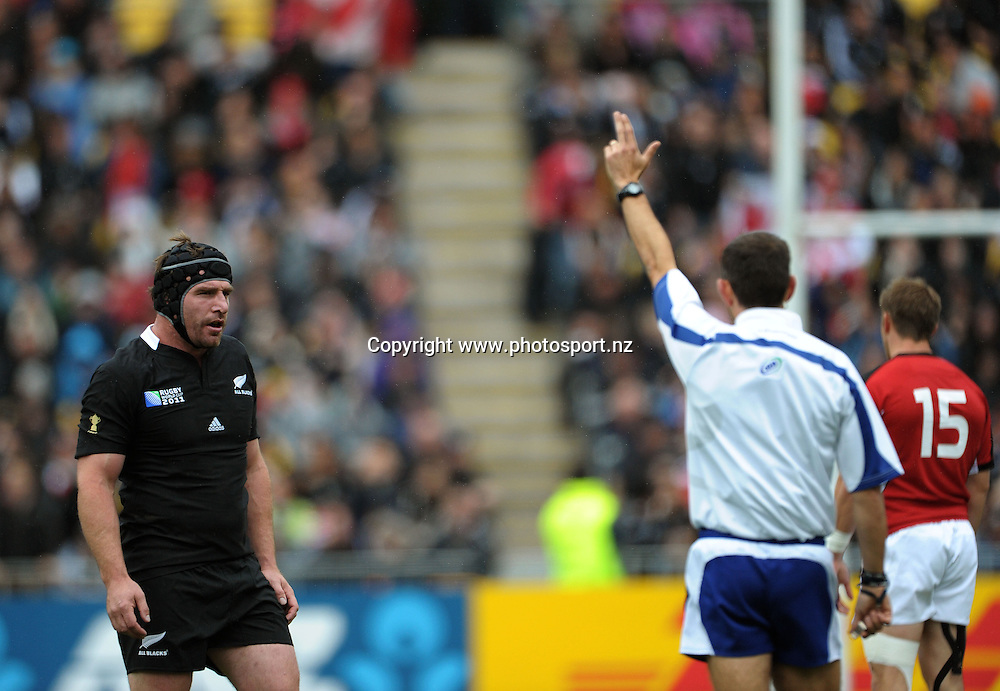 Refree Romain Poite awards a penalty to the All Blacks as Andrew Hore looks on during the All Blacks v Canada pool A match of the 2011 IRB Rugby World Cup at Wellington Regional Stadium, New Zealand on Sunday, 2 October 2011. Photo: Dave Lintott / photosport.co.nz