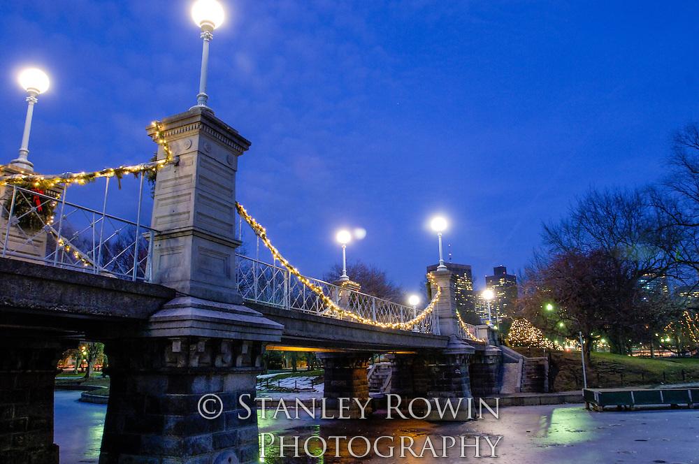 Suspension bridge over the middle of Boston Public Garden, nighttime photo