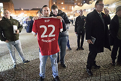 "© Licensed to London News Pictures . 03/11/2017 . Manchester , UK . A man with a Manchester United shirt with "" RIP 22 MANCHESTER "" printed on the back faces towards a counter protest organised by Unite Against Fascism . Fans of Tommy Robinson (real name Stephen Yaxley-Lennon ) and anti-fascist counter demonstrators at the launch of the former EDL leader's book "" Mohammed's Koran "" at Castlefield Bowl . Originally planned as a ticket-only event at Bowlers Exhibition Centre , the launch was moved at short notice to a public location in the city . Photo credit : Joel Goodman/LNP"