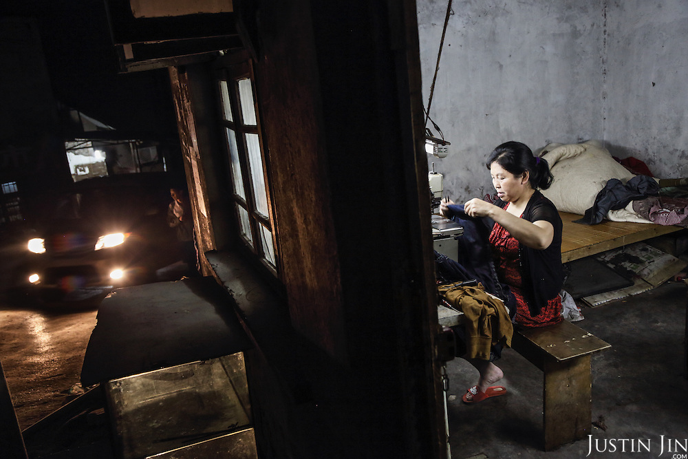 A 50-year-old rural migrant works in a garment sweatshop on the outskirts of the southwestern Chinese megapolis of Chongqing.<br /> <br /> They often work through the nights, earning 1,000 - 6,000 yuan per month depending on work load, a decent income compared with subsistence farming. <br /> <br /> For many, this is a long and arduous step in the transition from farming to urban living. <br /> <br /> China is hoping by relocating farmers into cities they would start to buy food, making a break from the cycle of farmers consuming only what they produce.<br /> <br /> China is pushing ahead with a dramatic, history-making plan to move 100 million rural residents into towns and cities between 2014 and 2020 &mdash; but without a clear idea of how to pay for the gargantuan undertaking or whether the farmers involved want to move.<br />