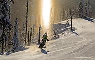 Jen Dolan skis through a sundog on corduroy groomed runs at Whitefish Mountain Resort in Montana model released