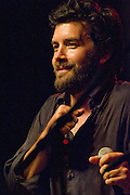 Bob Schneider performs at the Batfest! in Austin Texas, August 22, 2009. Bob Schneider (born October 12, 1965) is an Austin, Texas-based musician and artist, born in Ypsilanti, Michigan, and raised in Munich, Germany. The Batfest! is an annual Arts, Crafts, and Music festival at the location of the world's largest urban bat colony.