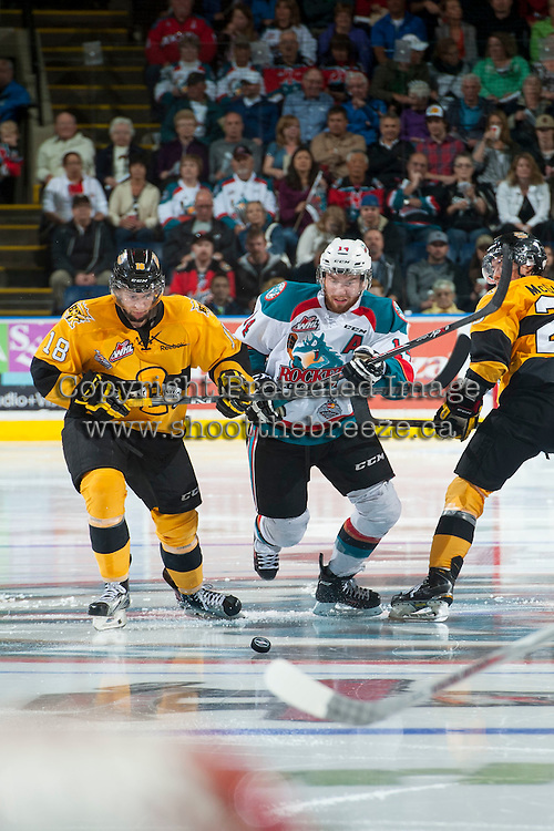 KELOWNA, CANADA - MAY 13: Morgan Klimchuk #18 of Brandon Wheat Kings checks Rourke Chartier #14 of Kelowna Rockets on May 13, 2015 during game 4 of the WHL final series at Prospera Place in Kelowna, British Columbia, Canada.  (Photo by Marissa Baecker/Shoot the Breeze)  *** Local Caption *** Morgan Klimchuk; Rourke Chartier;