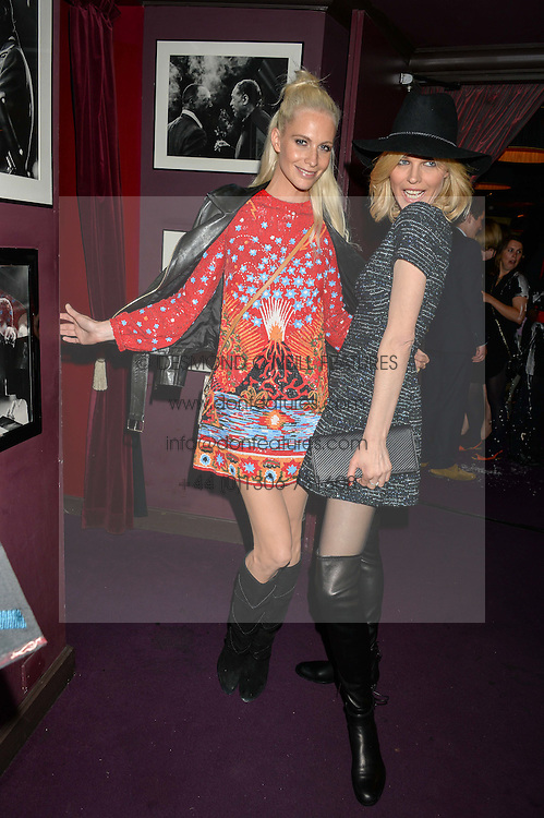 Left to right, POPPY DELEVINGNE and EVA HERZIGOVA at Hoping's Greatest Hits - the 10th Anniversary of The Hoping Foundation's charity benefit held at Ronnie Scott's, 47 Frith Street, Soho, London on 16th June 2016.