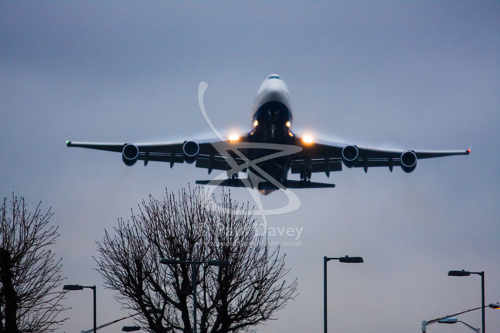 "January 3rd 2015, Heathrow Airport, London. Low cloud and rain provide ideal conditions to observe wake vortexes and ""fluffing"" as moisture condenses over the wings of landing aircraft. With the runway visible only at the last minute, several planes had to perform a ""go-round"", abandoning their first attempts to land. PICTURED: With water vapour ""fluffing"" over its wing surfaces, a British Airways Boeing 747 Jumbo Jet takes off from London Heathrow."