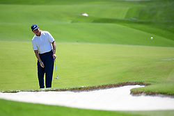 May 2, 2019 - Charlotte, NC, U.S. - CHARLOTTE, NC - MAY 02: Ernie Els hits an approach shot to the 14th green during the first round of the Wells Fargo Championship at Quail Hollow on May 2, 2019 in Charlotte, NC. (Photo by William Howard/Icon Sportswire) (Credit Image: © William Howard/Icon SMI via ZUMA Press)