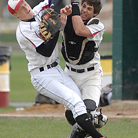 Laura Stoecker/lstoecker@dailyherald.com <br /> Batavia first baseman Joe Sortino, left, and catcher Jay Clark collide as they both go for a pop fly by Geneva in the second inning on Saturday, May 7.