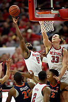 Wolfpack guard Eric Lockett (5) and forward Wyatt Walker (33) go for a rebound during ACC action against UVA.