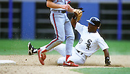 CHICAGO - UNDATED:  Tim Raines of the Chicago White Sox steals second base during an MLB game at Comiskey Park in Chicago, Illinois.  Raines played for the White Sox from 1991-1995. (Photo by Ron Vesely)  Subject:  Tim Raines