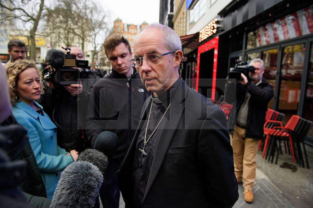 """© Licensed to London News Pictures. 02/02/2017. London, UK. Archbishop JUSTIN WELBY talks to media as he leaves the studio for LBC radio in London following a radio phone-in. Archbishop Welby has issued an """"unreserved and unequivocal"""" apology on behalf of the Church of England after admitting links to a 'child abuser'. Photo credit: Ben Cawthra/LNP"""