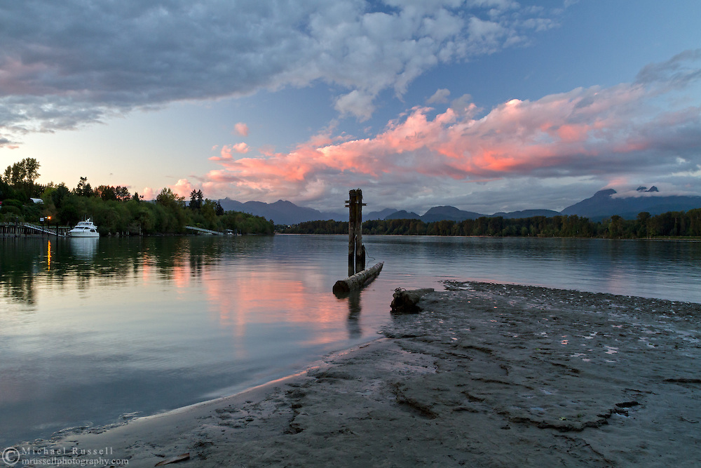 Sunset at Tavistock Point and the junction of the Fraser River and Bedford Channel at Brae Island Regional Park in Langley, British Columbia, Canada