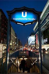View of Friedrichstrasse at night at entrance to Franzosische Strasse subway station in Mitte Berlin Germany