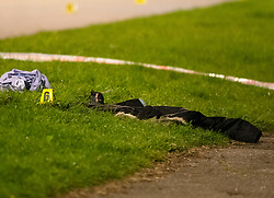 © Licensed to London News Pictures. 14/04/2019.<br /> Orpington, UK. A childs black coat on the side of the road. A child is in a critical condition in hospital after being hit by a blue car in Orpington, South East London. Traffic police are on scene with cordons in place on Court Road A224. Photo credit: Grant Falvey/LNP