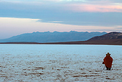 Photographer shooting Badwater Basin at sunrise, Death Valley National Park, California, United States of America