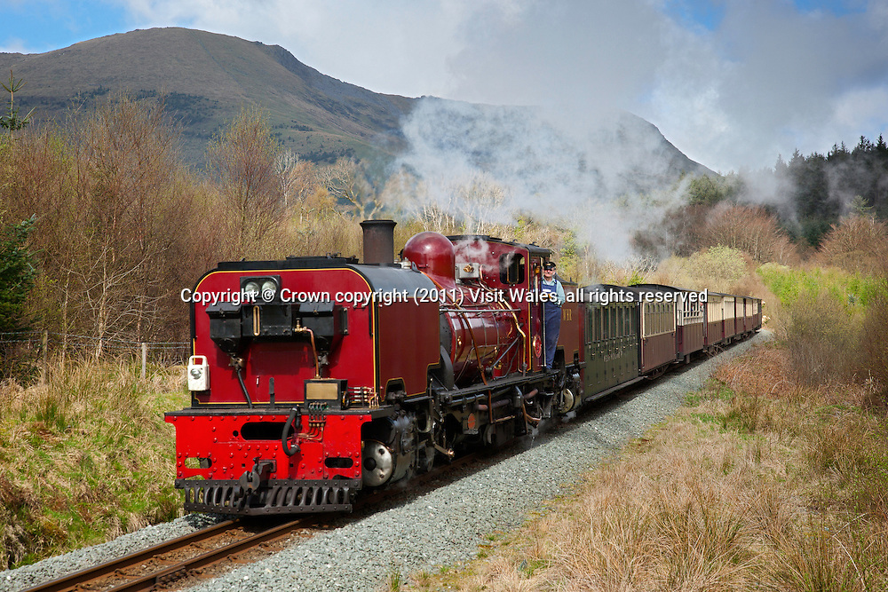 Locomotive south of Rhyd Ddu with Mynydd Drws-y-coed in background<br /> Welsh Highland Railway<br /> Snowdonia<br /> Gwynedd<br /> North<br /> Narrow Gauge<br /> Rail<br /> Transport