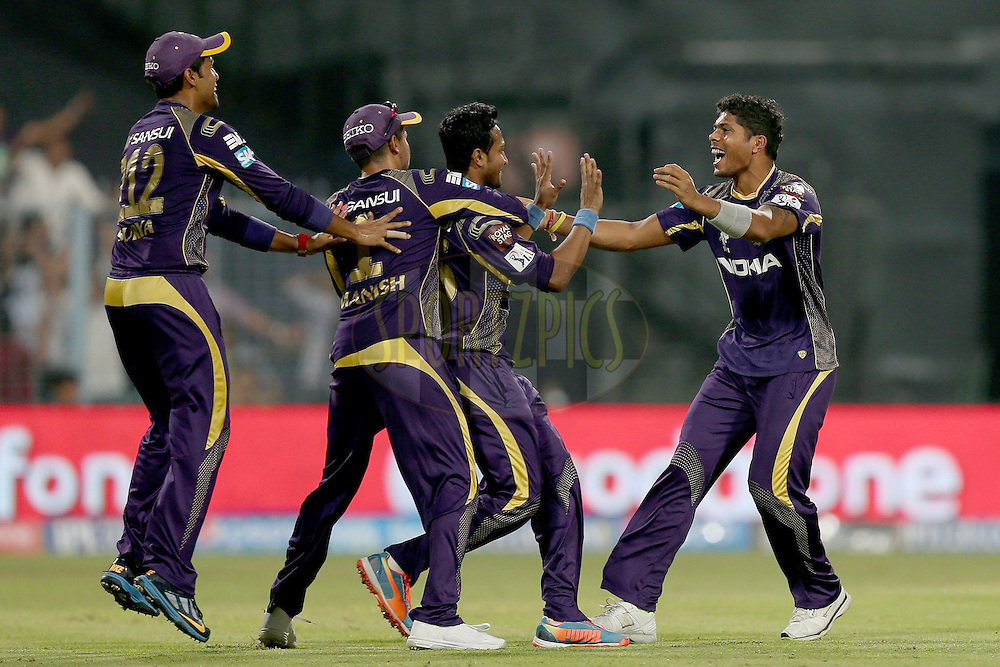 Umesh Yadav celebrates the wicket of Virender Sehwag with his teammates during the first qualifier match (QF1) of the Pepsi Indian Premier League Season VII 2014 between the Kings XI Punjab and the Kolkata Knight Riders held at Eden Gardens Cricket Stadium, Kolkata, India on the 28th May 2014. Photo by Jacques Rossouw / IPL / SPORTZPICS<br /> <br /> <br /> <br /> Image use subject to terms and conditions which can be found here:  http://sportzpics.photoshelter.com/gallery/Pepsi-IPL-Image-terms-and-conditions/G00004VW1IVJ.gB0/C0000TScjhBM6ikg