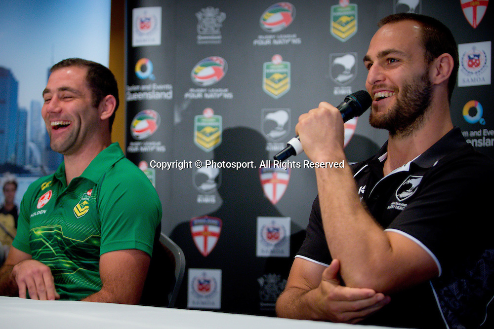 New Zealand captain Simon Mannering (R) and Australian captain Cameron Smithshare a laugh during a preview 4 Nations press conference, Brisbane Australia on October 24, 2014.