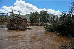 Kopa residents cross a makeshift bridge. Five days after tropical cyclone Idai cut a swathe through Mozambique, Zimbabwe and Malawi, the confirmed death toll stood at more than 300 and hundreds of thousands of lives were at risk, officials said.