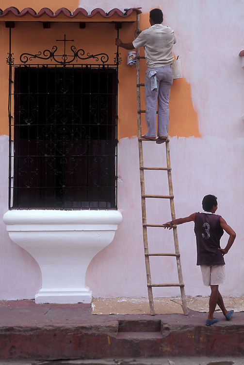 Repainting Spanish colonial house, Mompox, Bolivar, Colombia