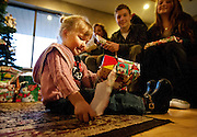 Eva Sebaske opens up her present, a Mrs. Potatohead donated by LDS Hospital employees from the Blood and Marrow Transplant division, at the Sebaske residence in Sandy, Monday, Dec. 17, 2012.