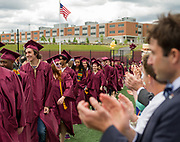Students enter to a standing ovation from parents and teachers during the Concord Carlisle High School graduation exercise for the Class of 2017 in Concord, June 3, 2017.   [Wicked Local Photo/James Jesson]