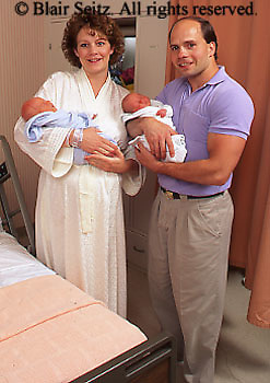 Medical, Maternity Hospital Care, Twins, Caucasian Father Mother and Twin Infants