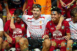 BANGKOK, THAILAND - Sunday, July 28, 2013: Liverpool's captain Steven Gerrard with two Thailand players after a preseason friendly match at the Rajamangala National Stadium. (Pic by David Rawcliffe/Propaganda)