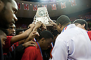 Dallas Kimball hoists their runner-up trophy after losing to Rosenberg Terry in the UIL 4A state championship game at the Frank Erwin Center in Austin on Saturday, March 9, 2013. (Cooper Neill/The Dallas Morning News)