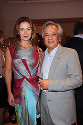 ANISH KAPOOR and his wife SUSANNAH at a party to celebrate the B.zero 1 design by Anish Kapoor held at Bulgari, 168 New Bond Street, London n 2nd June 2010.
