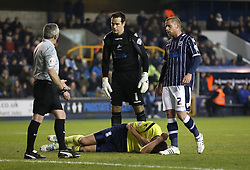 Millwall's David Forde and Alan Dunne check on the injured Birmingham City's Nikola Zigic - Photo mandatory by-line: Robin White/JMP - Tel: Mobile: 07966 386802 15/03/2014 - SPORT - FOOTBALL - The Den - Millwall - Millwall v Birmingham City - Sky Bet Championship