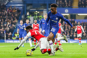 Chelsea midfielder Callum Hudson-Odoi (20) tussles with Arsenal midfielder Bukayo Saka (77) during the Premier League match between Chelsea and Arsenal at Stamford Bridge, London, England on 21 January 2020.