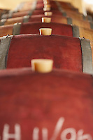 Wine casks lying down in order selective focus
