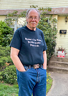 Garden City Park, New York, U.S. May 2, 2020. Bob Stuhmer social distancing in his front yard during dusk.