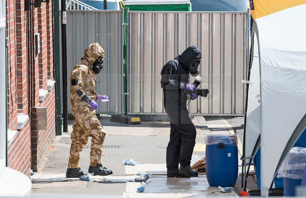 © Licensed to London News Pictures. 06/07/2018. Salisbury, UK. Specialist teams wearing hazmat suits are seen at John Baker House in Salisbury, Wiltshire an area visited by two people who are in critical condition after being exposed to the Novichok nerve agent. Dawn Sturgess, 44, and Charlie Rowley, 45 hav been confirmed as having come in to contact with the deadly agent after samples were sent to the MoD's Porton Down laboratory. Former Russian spy Sergei Skripal and his daughter Yulia were poisoned with Novichok nerve agent in nearby Salisbury in March 2018 causing diplomatic tentions between Russia and the UK. Photo credit: Ben Cawthra/LNP