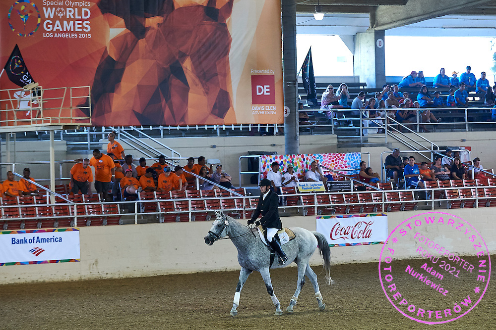 SO Poland athlete Pawel Bernat with horse called Sinatra competes in equestrian competition during eighth day of the Special Olympics World Games Los Angeles 2015 on August 1, 2015 at Equestrian Centre Riverside Drive Burbank in Los Angeles, USA.<br /> USA, Los Angeles, August 1, 2015<br /> <br /> Picture also available in RAW (NEF) or TIFF format on special request.<br /> <br /> For editorial use only. Any commercial or promotional use requires permission.<br /> <br /> Adam Nurkiewicz declares that he has no rights to the image of people at the photographs of his authorship.<br /> <br /> Mandatory credit:<br /> Photo by &copy; Adam Nurkiewicz / Mediasport